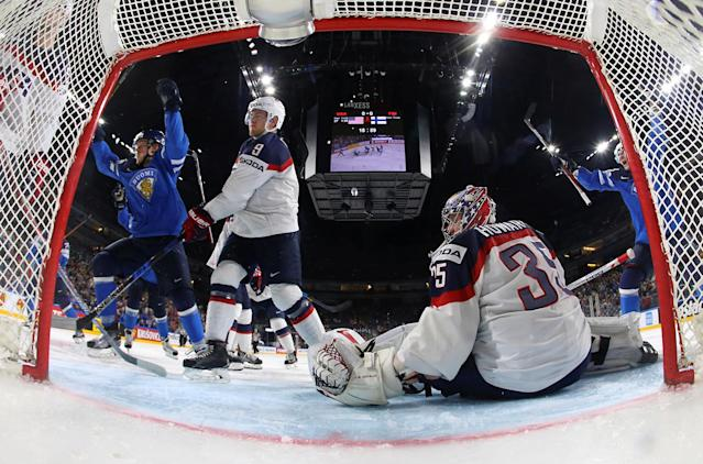 <p>Finland's Mikko Rantanen celebrates scoring a goal against U.S. goal tender Jimmy Howard in their quarterfinal match of the 2017 IIHF World Championships in Cologne, Germany, May 18, 2017.. (Photo: Wolfgang Rattay/Reuters) </p>