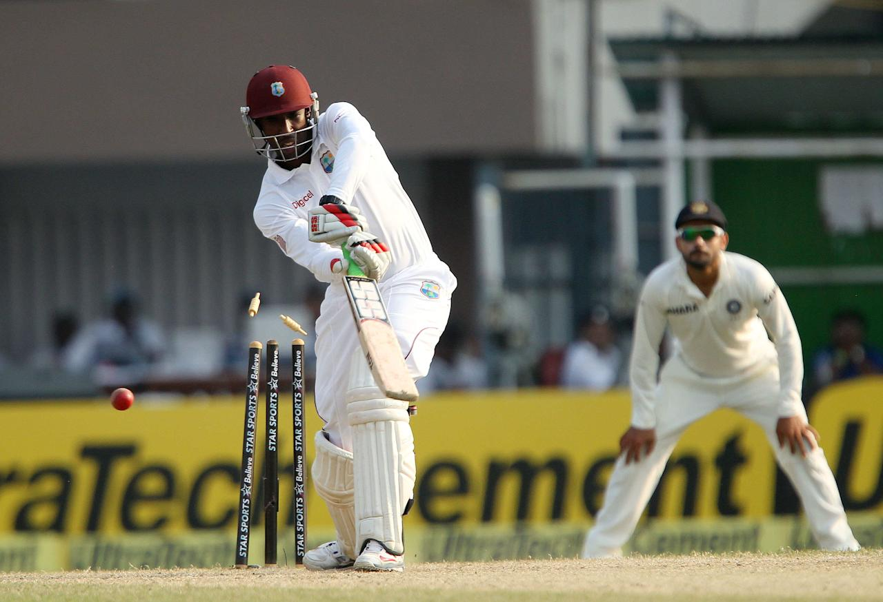 Shane Shillingford of West Indies  is bowled by  by Mohammed Shami during day three of the first Star Sports test match between India and The West Indies held at The Eden Gardens Stadium in Kolkata, India on the 8th November 2013  Photo by: Ron Gaunt - BCCI - SPORTZPICS