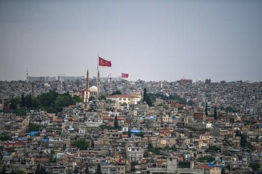 Flags flutter over the Turkish city of Gaziantep, home to around half a million Syrians who fled the civil war south of the border