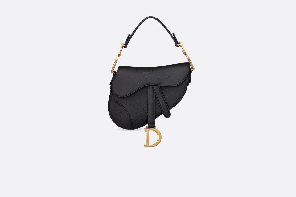 <p><span>Crafted from grained calfskin in black embossed, the iconic Saddle bag makes a fun return after it was portrayed lovingly in the hit TV series 'Sex and The City'.</span> </p>