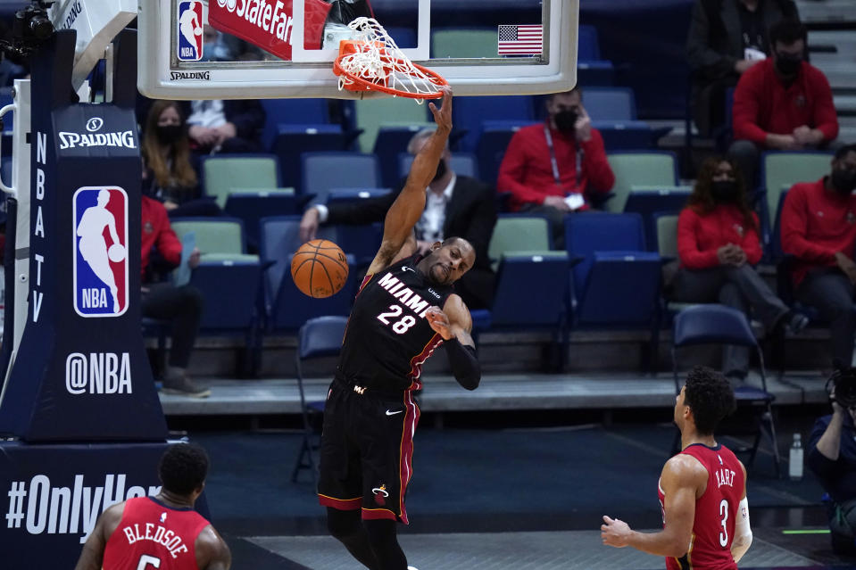 Miami Heat forward Andre Iguodala (28) dunks in front of New Orleans Pelicans guards Josh Hart (3) and Eric Bledsoe during the second half of an NBA basketball game in New Orleans, Thursday, March 4, 2021. (AP Photo/Gerald Herbert)
