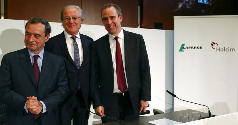 Current CEO of Lafarge Lafont, Reitzle, who will be chairman of the new merged entity LafargeHolcim, and upcoming CEO Olsen pose for the media after a news conference in Zurich