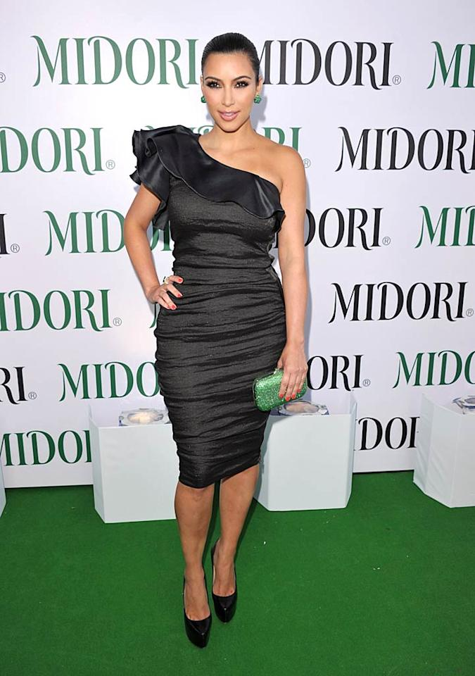 "Kim Kardashian showed off her curvaceous figure in a form-fitting, off-the-shoulder frock at the Midori Melon Liqueur Trunk Show. Love her or hate her, there's no denying the reality star's ability to rock an asymmetrical dress. John Shearer/<a href=""http://www.wireimage.com"" target=""new"">WireImage.com</a> - May 10, 2011"