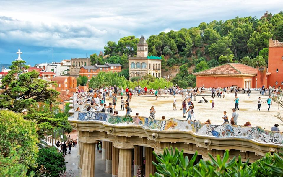 Tourists in Barcelona's Park Guell in normal times. Spain is also keen to ensure travellers are free to visit this year - RomanBabakin