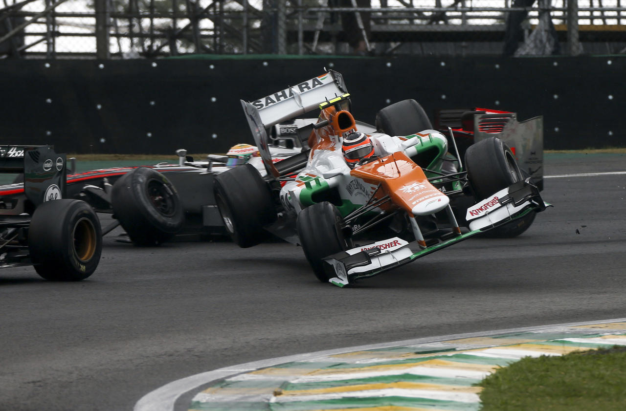SAO PAULO, BRAZIL - NOVEMBER 25:  Nico Hulkenberg Of Germany and Force India crashes into Lewis Hamilton of Great Britain and McLaren during the Brazilian Formula One Grand Prix at the Autodromo Jose Carlos Pace on November 25, 2012 in Sao Paulo, Brazil.  (Photo by Peter J Fox/Getty Images)