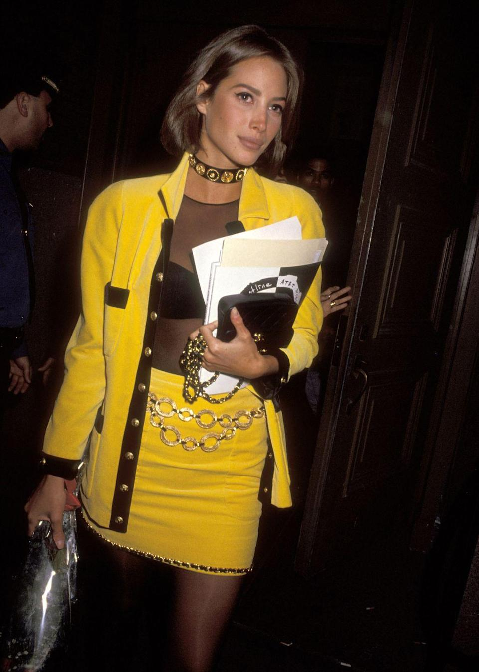 <p>Monochrome primary colors made the skirt suit a power suit of sorts. Fashion girls like Christy Turlington wore them with a sheer mesh top and chain-link accessories. </p>