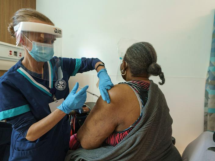 Los Angeles health workers administer COVID-19 vaccinations on Feb. 24.