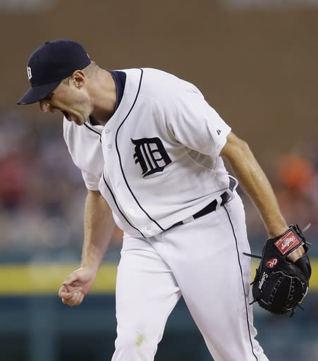 Detroit Tigers starting pitcher Max Scherzer reacts after giving up a solo home run to Cleveland Indians' Chris Dickerson during the sixth inning in the second baseball game of a doubleheader, Saturday, July 19, 2014 in Detroit. (AP Photo/Carlos Osorio)