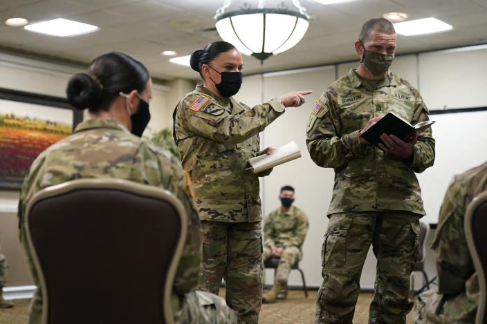 Soldiers give feedback to and Sgt. Maj. Julie Guerra, People First Task Force, center, and Segreant Major of the Army Michael Grinston, right, about their concerns at Fort Hood, Texas, Thursday, Jan. 7, 2021. Following more than two dozen soldier deaths in 2020, including multiple homicides, the U.S. Army Base is facing an issue of distrust among soldiers. (AP Photo/Eric Gay)