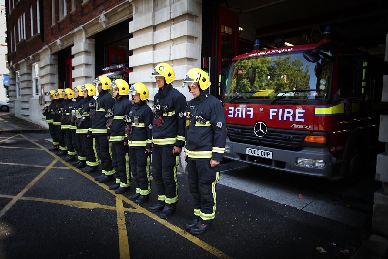 Members of Clerkenwell Fire Station's Green Watch observe a minutes silence for their fellow fire-fighters who lost their lives in the 9/11 terrorist attacks in New York, September 11, 2011 in London, England. Ceremonies held around the world have joined Washington and New York as they commemorate the tenth anniversary of the 9/11 terrorist attacks where nearly 3000 people died when four hijacked airliners were used in coordinated attacks against the United States.  (Photo by Peter Macdiarmid/Getty Images)