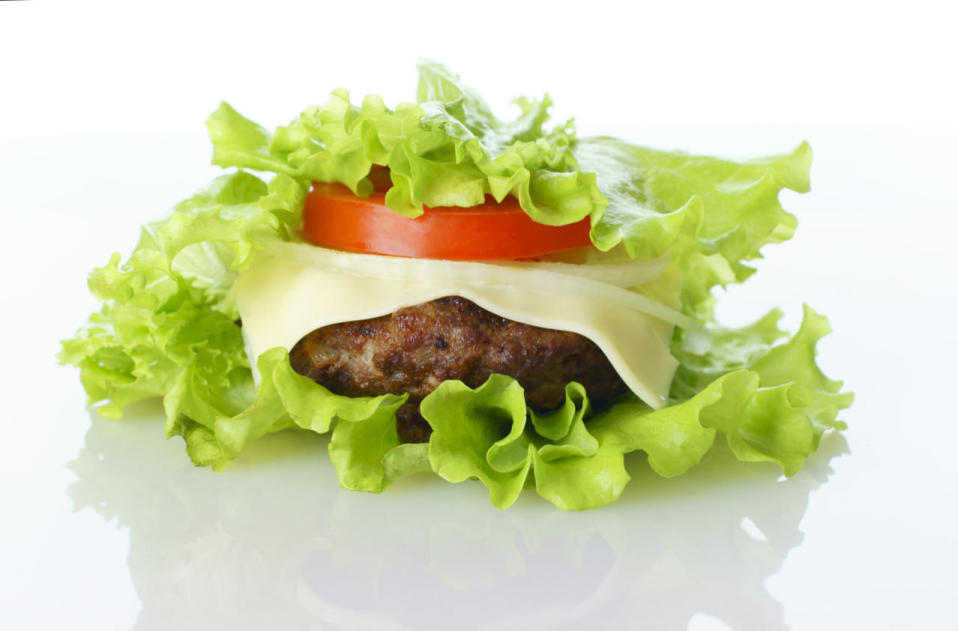 <p>Ask for your burger made protein-style: everything sandwiched between lettuce wraps. This is a refreshing alternative that won't leave you wanting to unbutton your pants after the meal. <i>(Photo Credit: Getty Images)</i></p>