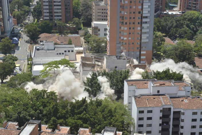 Clouds of dust rise during the implosion of a six-floor apartment building that former cartel boss Pablo Escobar once called home, in Medellin, Colombia, Friday, Feb. 22, 2019. Mayor Federico Gutierrez had been pushing to raze the building and erect in its place a park honoring the thousands of victims, including four presidential candidates and some 500 police officers, killed by Escobar's army of assassins during the Medellin cartel's heyday in the 1980s and 1990s. (AP Photo/Luis Benavidez)