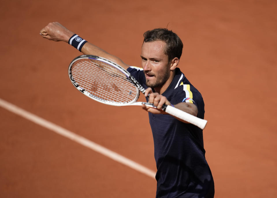 Russia's Daniil Medvedev celebrates after winning a point againstChile's Cristian Garin during their fourth round match on day 8, of the French Open tennis tournament at Roland Garros in Paris, France, Sunday, June 6, 2021. (AP Photo/Christophe Ena)