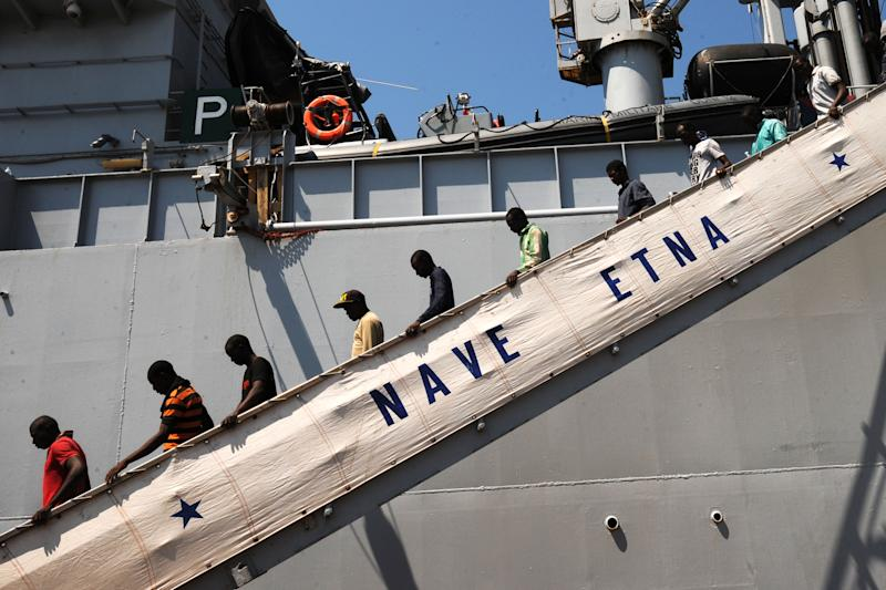 """Migrants disembark from Italian military ship """"Etna"""" on July 19, 2014 in the port of Salerno, southern Italy, after a rescue operation (AFP Photo/Mario Laporta)"""