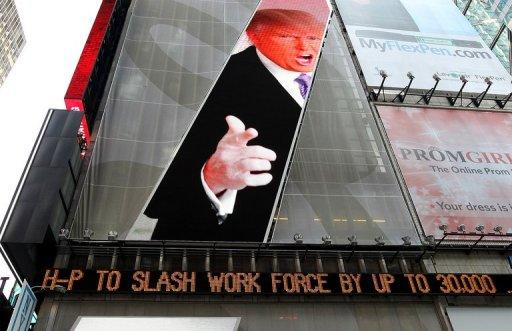 An image of Donald Trump is seen above a message board announcing job cuts at Hewlett-Packard in New York's Times Square on May 17. The move came as the California-based firm reported a 31% drop in profits in its second fiscal quarter to $1.6 bn