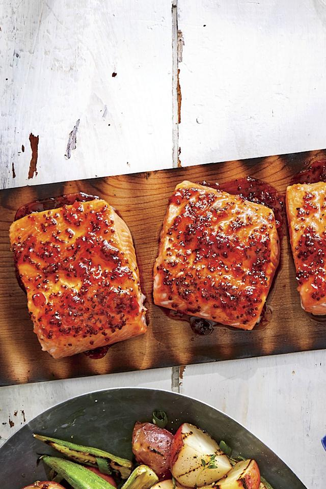 "<p><b>Recipe: </b><strong><a href=""https://www.southernliving.com/recipes/bbq-cedar-plank-salmon"">BBQ-Glazed Cedar-Plank Salmon</a></strong></p> <p>Fire up the grill and throw this BBQ cedar plank salmon on, for a nice switch-up from the usual hamburgers and hotdogs.</p>"