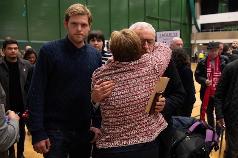 LONDON, ENGLAND - DECEMBER 13: Ben Corbyn (L) stands by as Labour Party leader Jeremy Corbyn (R) and Shadow Foreign Secretary Emily Thornberry (C) meet after they both retained their Parliamentary seats following the count at Sobell leisure centre on December 13, 2019 in London, England. Labour leader Jeremy Corbyn has held the Islington North seat since 1983. The current Conservative Prime Minister Boris Johnson called the first UK winter election for nearly a century in an attempt to gain a working majority to break the parliamentary deadlock over Brexit. The election results from across the country are being counted overnight and an overall result is expected in the early hours of Friday morning. (Photo by Leon Neal/Getty Images)