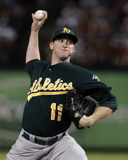 Oakland Athletics' Jarrod Parker (11) delivers to the Texas Rangers in the second inning of a baseball game, Wednesday, Sept. 26, 2012, in Arlington, Texas. (AP Photo/Tony Gutierrez)