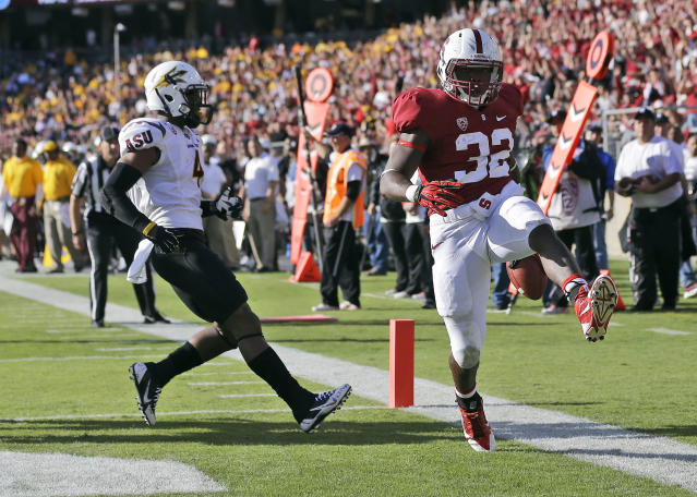 Stanford running back Anthony Wilkerson (32) celebrates after a touchdown run past Arizona State safety Alden Darby, left, during the first half of an NCAA college football game Saturday, Sept. 21, 2013, in Stanford, Calif. (AP Photo/Marcio Jose Sanchez)