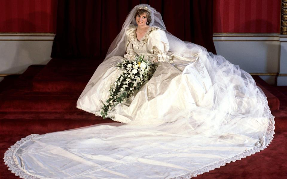 Princess Diana on her wedding day; she wore the Spencer tiara and a gown with a 25ft train, the longest ever worn by a royal bride - PA