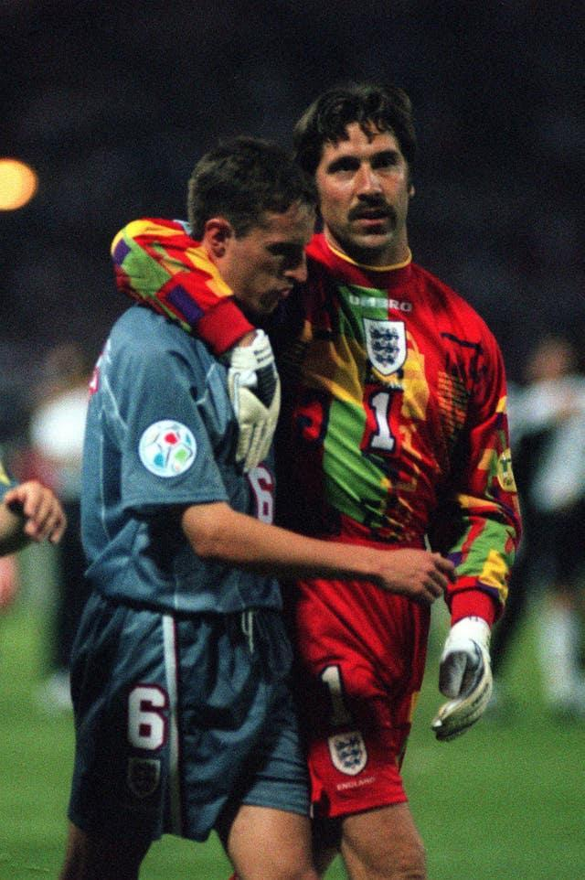 Seaman consoles Southgate after his penalty was saved in the shootout against Germany at Euro 96