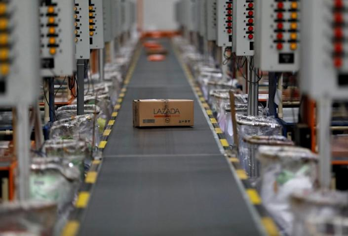 FILE PHOTO: A package for delivery is seen on a conveyor belt at online retailer Lazada's warehouse in Depok