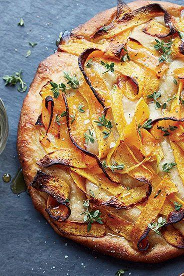 """<p>Scatter sweet, tender strips of roasted butternut squash and thyme on top of focaccia dough for an easy vegan Thanksgiving recipe. Skip the honey all together, or sub in agave or maple syrup for added sweetness! </p><p><em><a href=""""https://www.goodhousekeeping.com/food-recipes/a16197/focaccia-roasted-squash-recipe-fw1114/"""" rel=""""nofollow noopener"""" target=""""_blank"""" data-ylk=""""slk:Get the recipe for Focaccia with Roasted Squash »"""" class=""""link rapid-noclick-resp"""">Get the recipe for Focaccia with Roasted Squash »</a></em></p>"""