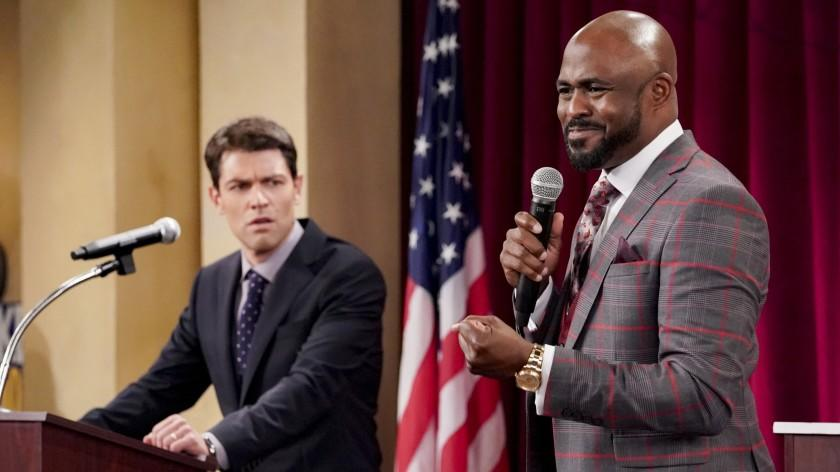 """The Neighborhood -- CBS TV Series, """"Welcome to the Election"""" - Pictured: Max Greenfield (Dave Johnson) and Wayne Brady (Isaiah Evans). Dave faces off against incumbent Isaiah Evans (guest star Wayne Brady) in a debate for a city council seat, and the race comes to a dramatic conclusion, on THE NEIGHBORHOOD, Monday, Nov. 23 (8:00-8:30 PM, ET/PT) on the CBS Television Network. Photo: Monty Brinton/CBS ©2020 CBS Broadcasting, Inc. All Rights Reserved. Max Greenfield, left, and Wayne Brady in """"The Neighborhood"""" on CBS."""