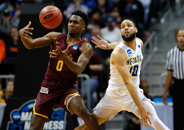 Loyola-Nevada came down to the final minutes, as Donte Ingram (0) and Caleb Martin (10) did battle. (Getty)