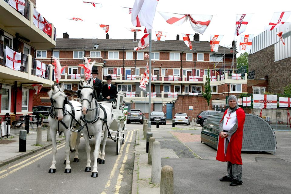 Alan Putman, in costume and a horse-drawn carriage, on the Kirby Estate in Bermondsey, south London, where residents are showing their support for England ahead of their game against Denmark at Wembley (PA Wire)