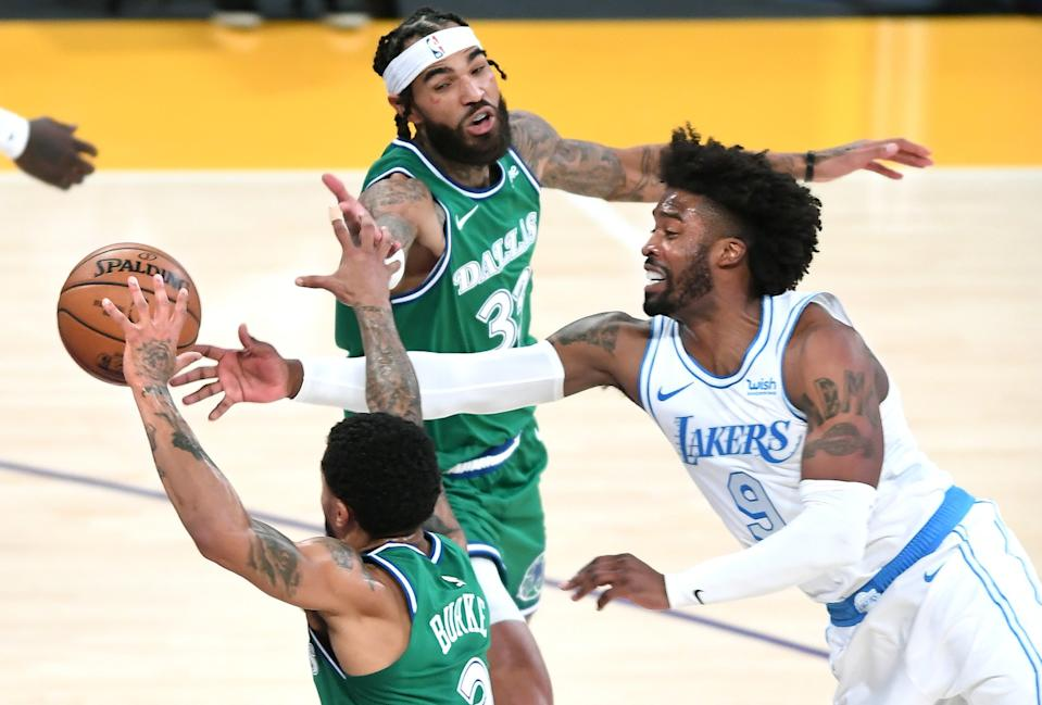 Lakers guard Wesley Matthews battles for a loose ball with Mavericks guard Trey Burke and center Willie Cauley-Stein.
