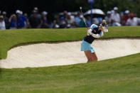 Nelly Korda of the U.S. hits from the fairway bunker on the ninth hole, during the final round of play in the KPMG Women's PGA Championship golf tournament Sunday, June 27, 2021, in Johns Creek, Ga. (AP Photo/John Bazemore)