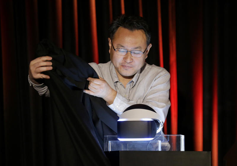 Shuhei Yoshida, president of Sony Computer Entertainment Worldwide Studios, unveils the PlayStation 4 virtual reality headset Project Morpheus at the Game Developers Conference 2014 in San Francisco, Tuesday, March 18, 2014. (AP Photo/Jeff Chiu)