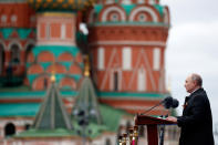 Russian President Vladimir Putin delivers his speech during the Victory Day military parade in Moscow, Russia, Sunday, May 9, 2021, marking the 76th anniversary of the end of World War II in Europe. (Mikhail Metzel, Sputnik, Kremlin Pool Photo via AP)