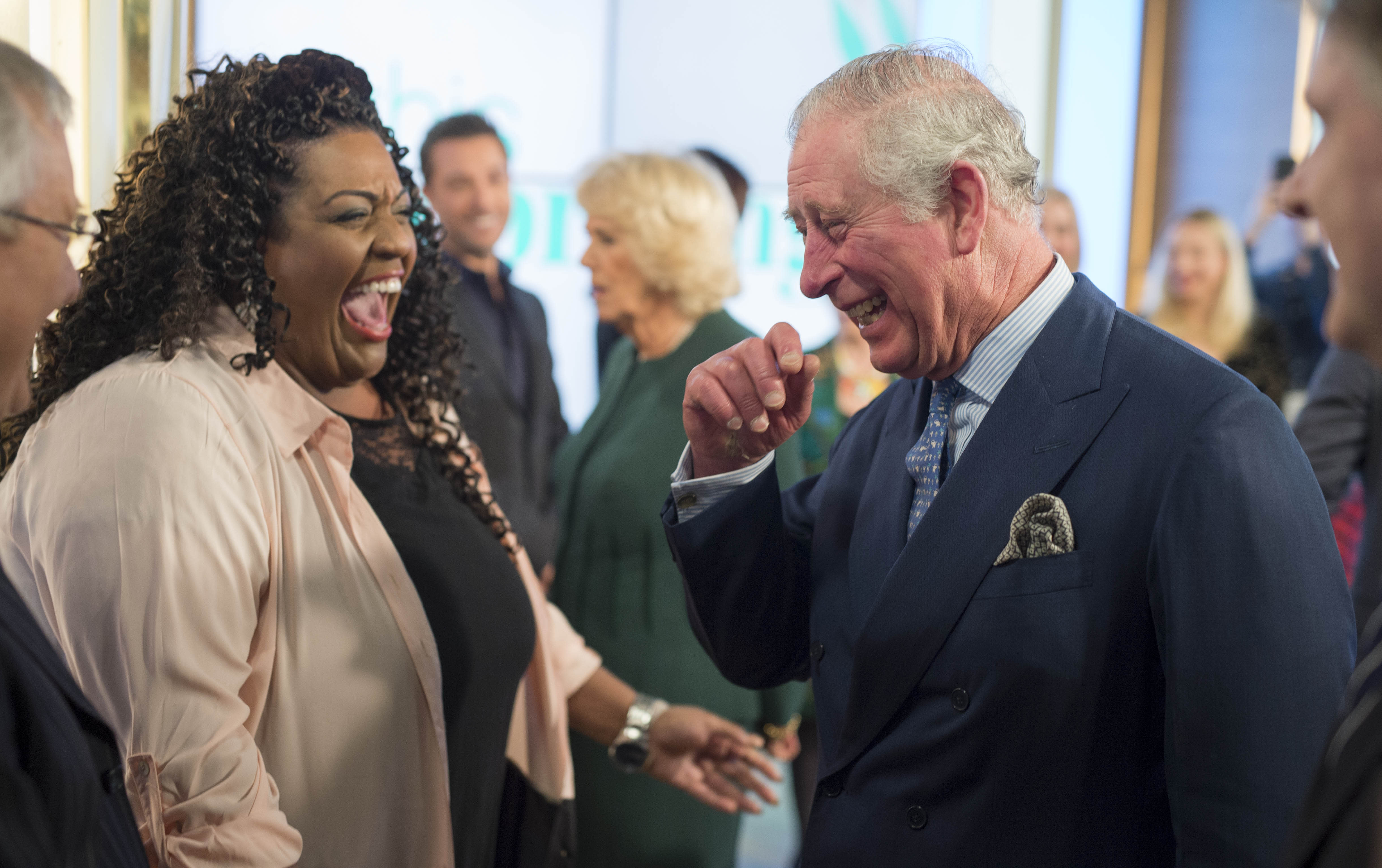 "LONDON, UNITED KINGDOM - JANUARY 31: Prince Charles, Prince of Wales shares a joke with presenter Alison Hammond during a visit to ITV's ""This Morning"" to celebrate the 90th anniversary of the Royal Television Society at London Television Centre on January 31, 2018 in London, United Kingdom. (Photo by Geoff Pugh - WPA Pool/Getty Images)"