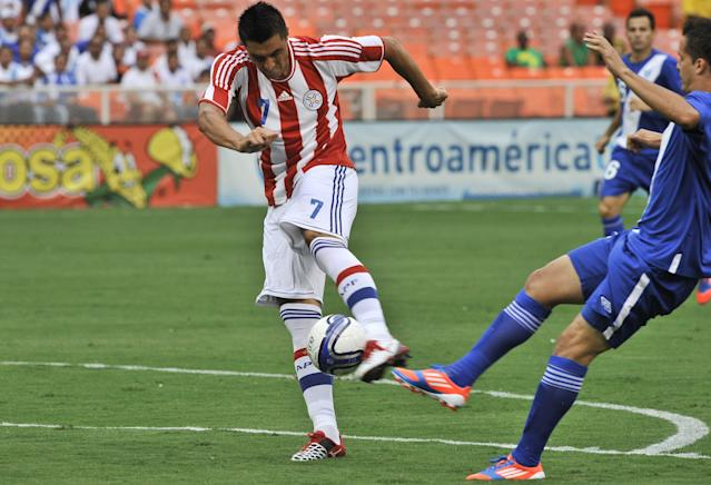 Paraguay's Oscar Cardozo shoots to score against Guatemala during a friendly 2014 World Cup qualifying warm up match in Washington on August 15, 2012. AFP PHOTO/Nicholas KAMMNICHOLAS KAMM/AFP/GettyImages