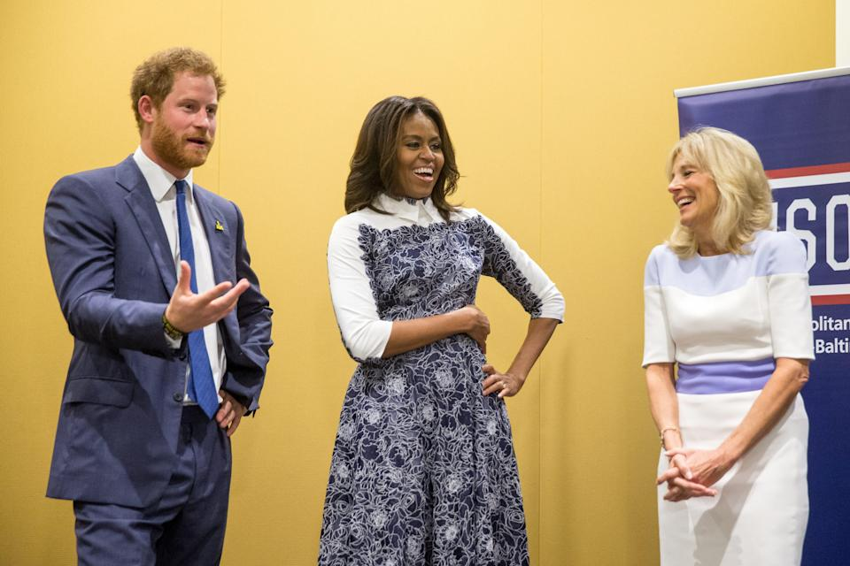 Britain's Prince Harry, first lady Michelle Obama and Jill Biden tour the USO Warrior and Family Center at the Fort Belvoir, Va., military base in 2015.