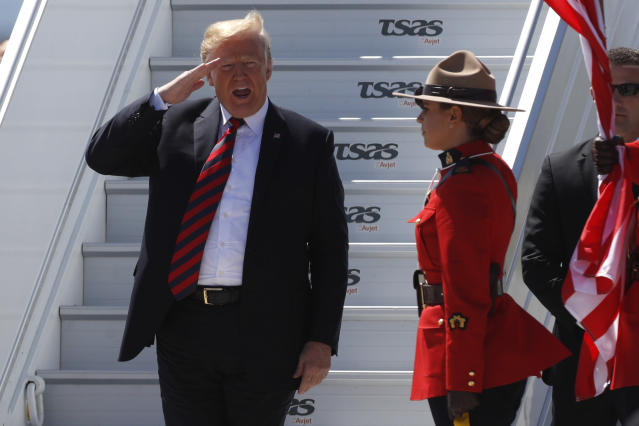 <p>President Donald Trump salutes as he arrives at Canadian Forces Base Bagotville for the G7 summit, June 8, 2018. (Photo: Lars Hagberg/AFP/Getty Images) </p>