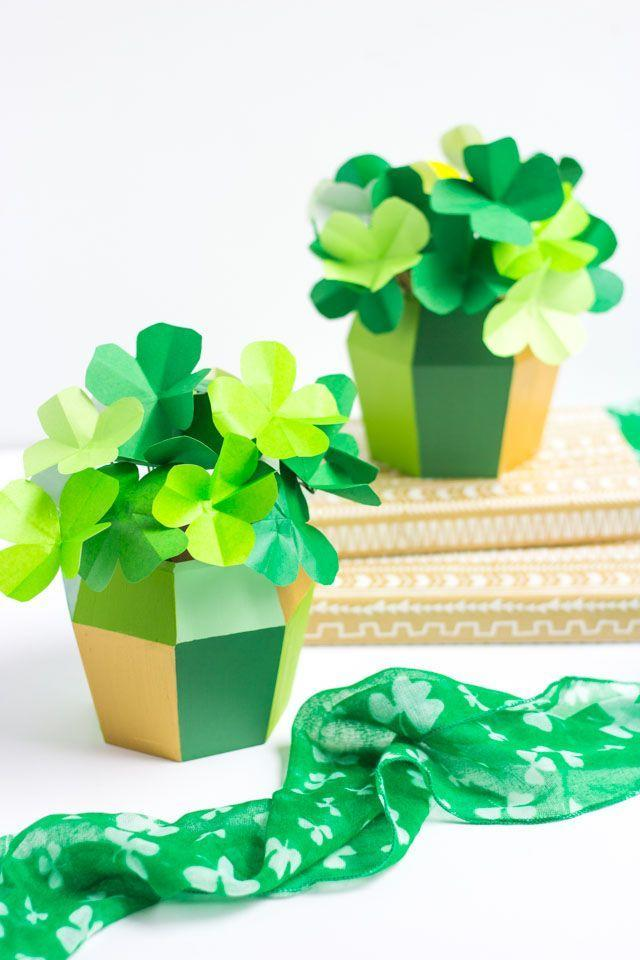 """<p>Give your nearest and dearest a little <a href=""""https://www.countryliving.com/life/g19045953/st-patricks-day-quotes/"""" rel=""""nofollow noopener"""" target=""""_blank"""" data-ylk=""""slk:luck of the Irish"""" class=""""link rapid-noclick-resp"""">luck of the Irish </a>with some paper four-leaf clovers in matching mini pots. </p><p><strong>Get the tutorial at <a href=""""http://www.designimprovised.com/2017/03/diy-potted-paper-shamrocks.html"""" rel=""""nofollow noopener"""" target=""""_blank"""" data-ylk=""""slk:Design Improvised"""" class=""""link rapid-noclick-resp"""">Design Improvised</a>. </strong></p><p><strong><a class=""""link rapid-noclick-resp"""" href=""""https://www.target.com/p/hand-made-modern-small-wood-planter-septagon-5-x-5/-/A-50277477"""" rel=""""nofollow noopener"""" target=""""_blank"""" data-ylk=""""slk:SHOP PLANTERS"""">SHOP PLANTERS</a><br></strong></p>"""
