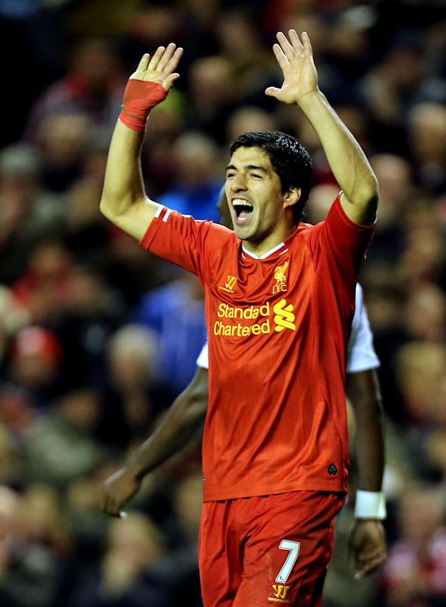 Liverpool's Luis Suarez celebrates his goal against West Ham United during their English Premier League soccer match at Anfield, Liverpool, England, Saturday, Dec. 7, 2013. (AP Photo/Peter Byrne, PA Wire)
