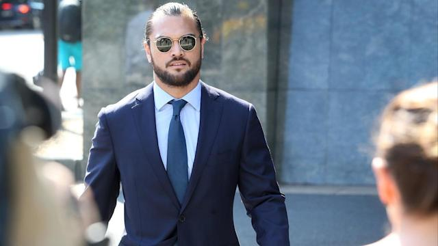 <p>Rugby union's Karmichael Hunt remains stood down by the Queensland Reds despite avoiding conviction.</p>