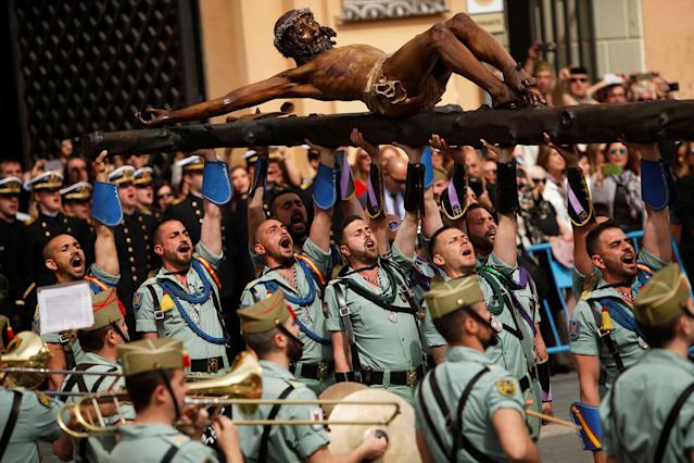 <p>Spanish legionnaires carry a statue of the Christ of Mena outside a church during a ceremony ahead of the Mena brotherhood procession during Holy Week, in Malaga, Spain, March 29, 2018. (Photo: Jon Nazca/Reuters) </p>