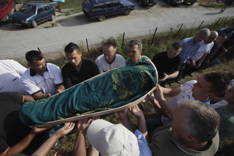 In this Saturday Aug. 11, 2012 photo Bosnian men carry the coffin of 6-year-old Tarik Bijelic during his funeral in the village of Olovske Luke, 60 kilometers north of Sarajevo, Bosnia. Tarik Bijelic was hit by a land mine last week as he scavenged in the forest for firewood to help his family make ends meet. He died in his father's arms. Under an international treaty, Bosnia was supposed to be free of mines by 2009. Instead, it has quietly obtained another decade to clear the estimated 1,300 remaining square kilometers (500 square miles) of mine fields. In the 16 years since Bosnia's three-year war ended, mines have killed 591 people. So far this year, seven people have been killed and 3 maimed. (AP Photo/Amel Emric)