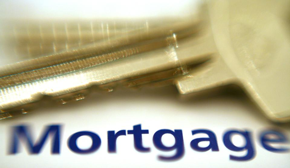 A growing number of homeowners are asking about breaking mortgage early for lower rates (Getty Images)