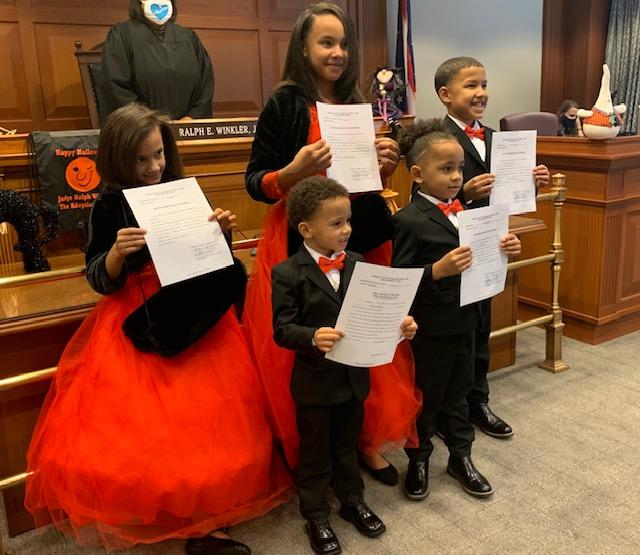 Siblings Marionna, Makayla, Robert, Giovanni and Kiontae smile proudly after being adopted by Robert Carter on National Adoption Day (Photo: Robert Carter)