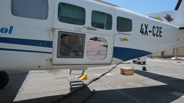 """This undated handout photo, provided by the Israeli Ministry of Defense, shows a high-power Laser system installed on an aircraft at an undisclosed location. The prototype, developed with Elbit Systems, was mounted on a civilian plane and successfully shot down """"several"""" drones in a recent test over the Mediterranean Sea, according to Brig. Gen. Yaniv Rotem, head of military research and development at the Defense Ministry on Monday, June 21, 2021. (Ministry of Defense Spokesperson's Office via AP)"""