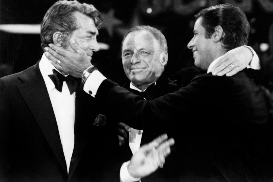 <p>Lewis reunited with Dean Martin (a truce brokered by Rat Pack kingpin Frank Sinatra) at the 1976 edition of his annual star-studded Labor Day telethon that raised millions for the Muscular Dystrophy Association and solidified Lewis's reputation as a humanitarian. (Photo: Everett Collection) </p>