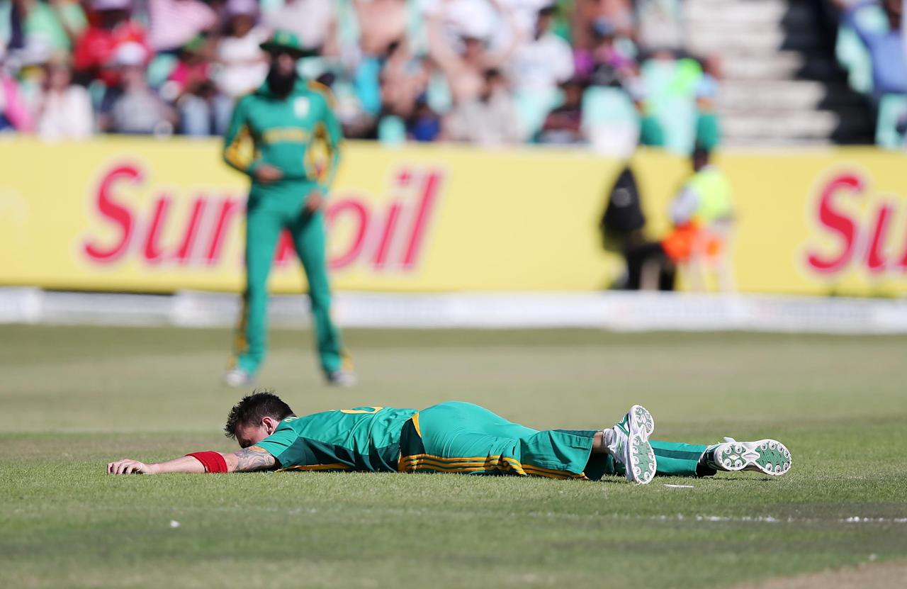 Dale Steyn of South Africa lies on the ground during the  ODI match between South Africa and Pakistan at Sahara Stadium Kingsmead on March 21, 2013 in Durban, South Africa. AFP PHOTO  / Stringer        (Photo credit should read -/AFP/Getty Images)