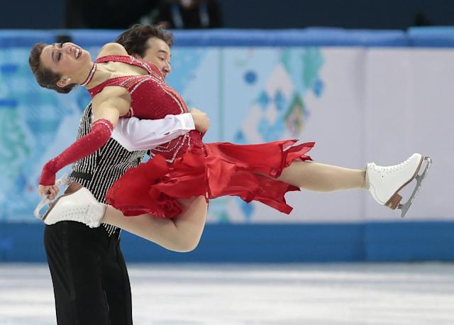 Cathy Reed and Chris Reed of Japan compete in the team ice dance short dance figure skating competition at the Iceberg Skating Palace during the 2014 Winter Olympics, Saturday, Feb. 8, 2014, in Sochi, Russia. (AP Photo/Ivan Sekretarev)