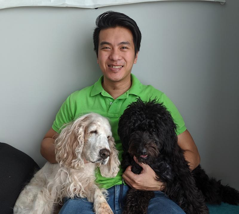 Tan with his two loving dogs. — Picture courtesy of Louis Tan